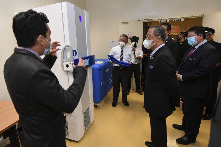 Prime Minister Tan Sri Muhyiddin Yassin today observed preparations made by the National Cancer Institute (IKN) here ahead of the implementation of the first phase of the National Covid-19 Immunisation Programme, which begins on Wednesday (Feb 24). - Bernama pic
