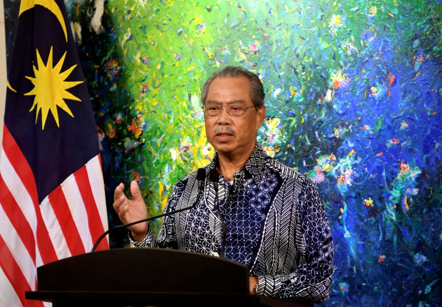 Prime Minister Tan Sri Muhyiddin Yassin delivering a speech regarding the current COVID-19 situation that was broadcasted live from his residence today. - Bernama pic