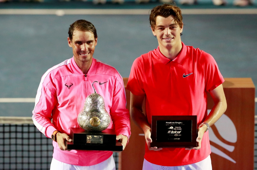 Tennis - ATP 500 - Mexican Open - Princess Acapulco Stadium, Acapulco, Mexico - February 29, 2020 Spain's Rafael Nadal celebrates with the trophy and Taylor Fritz of the U.S. the runner up of the Mexican Open REUTERS/Henry Romero