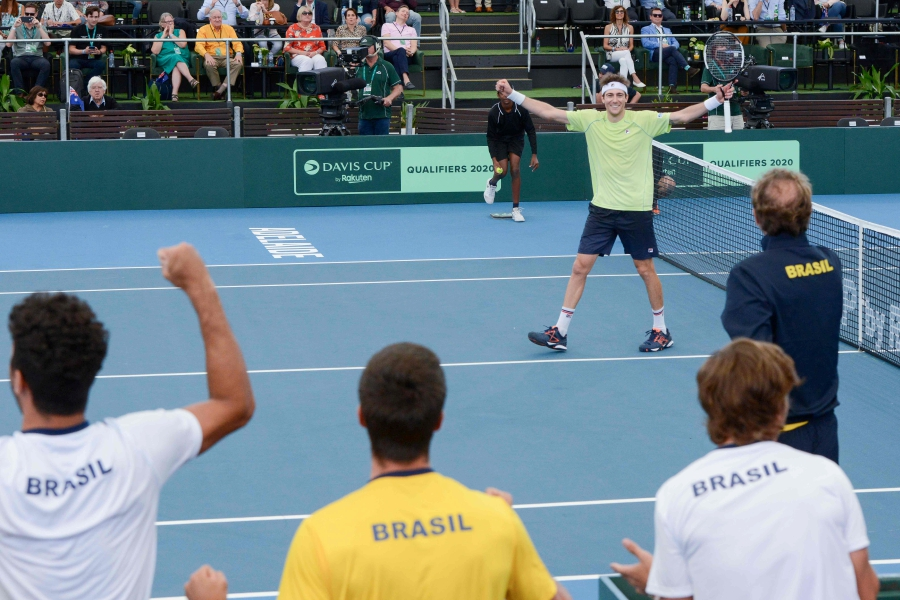 Brazilian player Marcelo Demoliner celebrates with team mates for winning his Davis Cup doubles qualifying tie against Australia in Adelaide. - Pix: AFP
