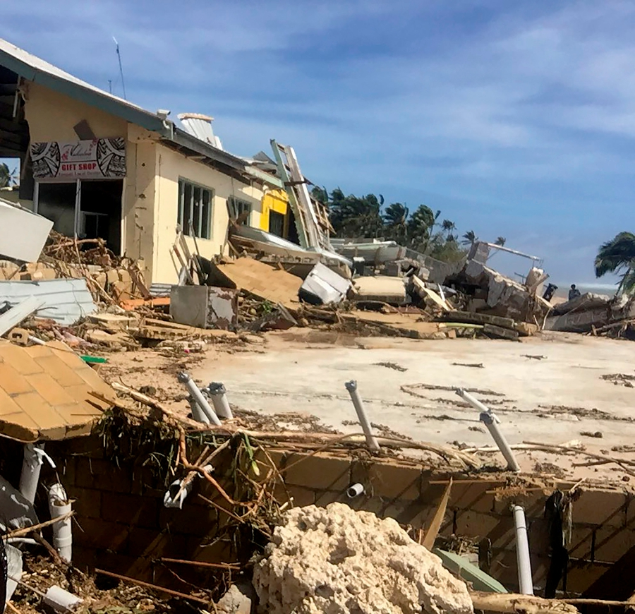 This handout photo taken and released by the Tonga Police on April 9, 2020 shows damage to a tourist resort cause by Tropical Cyclone Harold in the Hihifo coastal area. - A resurgent Tropical Cyclone Harold flattened tourist resorts in Tonga on April 9, extending a week-long trail of destruction across four South Pacific island nations that has claimed more than two dozen lives. (Photo by Handout / TONGA POLICE / AFP)