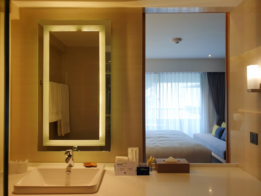The ensuite bathroom has a sliding panel which opens up to the room.