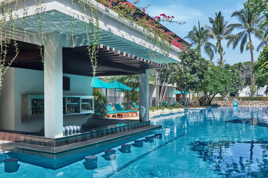 Three swim-up pool bars ready to serve up a wide range of thirst-quenching tropical drinks and light snacks.