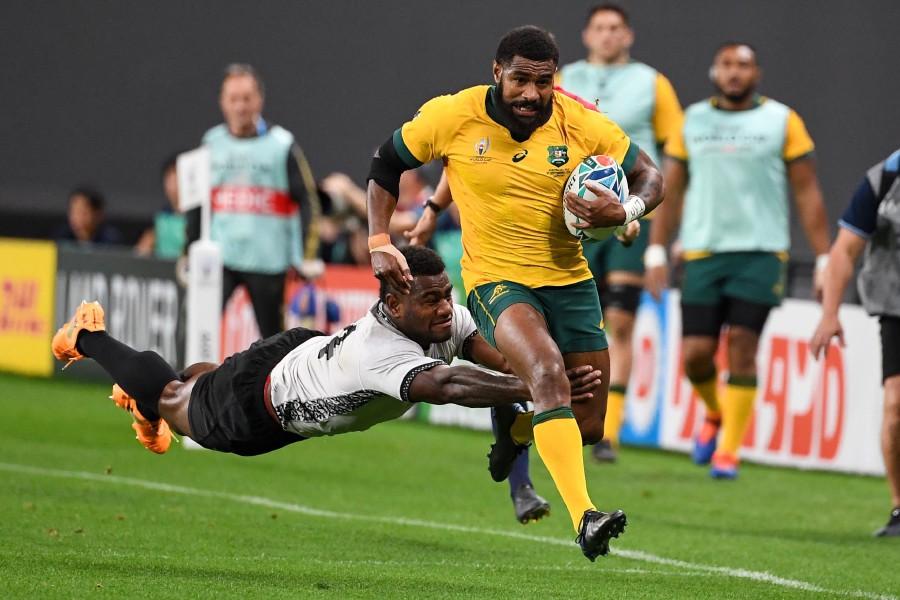 Fiji's wing Josua Tuisova (left) tackles Australia's wing Marika Koroibete. - AFP
