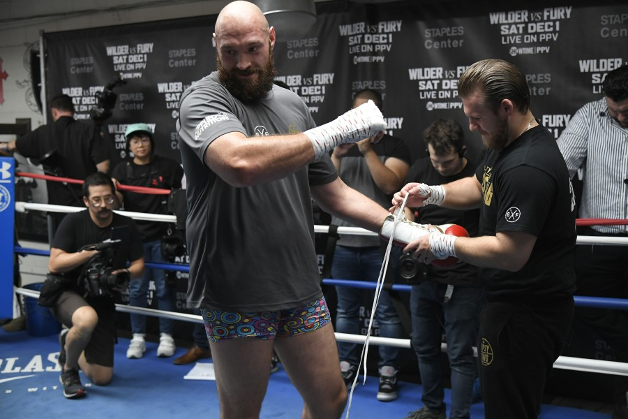 Trainer Ben Davison unwraps the hands of Lineal Heavyweight Champion Tyson Fury during a work out session in front of Los Angeles media in advance of his highly anticipated WBC Heavyweight World Championship against undefeated WBC World Champion Deontay Wilder on December 1at Churchill Boxing Club on October 25, 2018 in Los Angeles, California. AFP