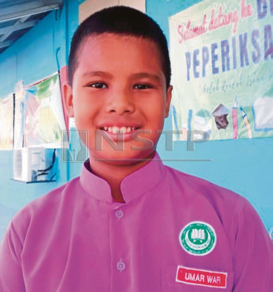 Sekolah Rendah Islam Hira' Klang student, Umar Wafi Zulkafri, 10 is the brain behind the Anti-Bully Notification System. Pix by Faliq Lajim