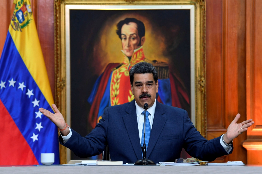 """(FILES) In this file photo taken on February 14, 2020 Venezuela's President Nicolas Maduro gestures during a press conference with members of the foreign media at Miraflores palace in Caracas. - The US Justice Department announced the indictment of Venezuelan President Nicolas Maduro on March 26, 2020 for """"narco-terrorism"""" and offered 15 million for information leading to his capture. (Photo by YURI CORTEZ / AFP)"""