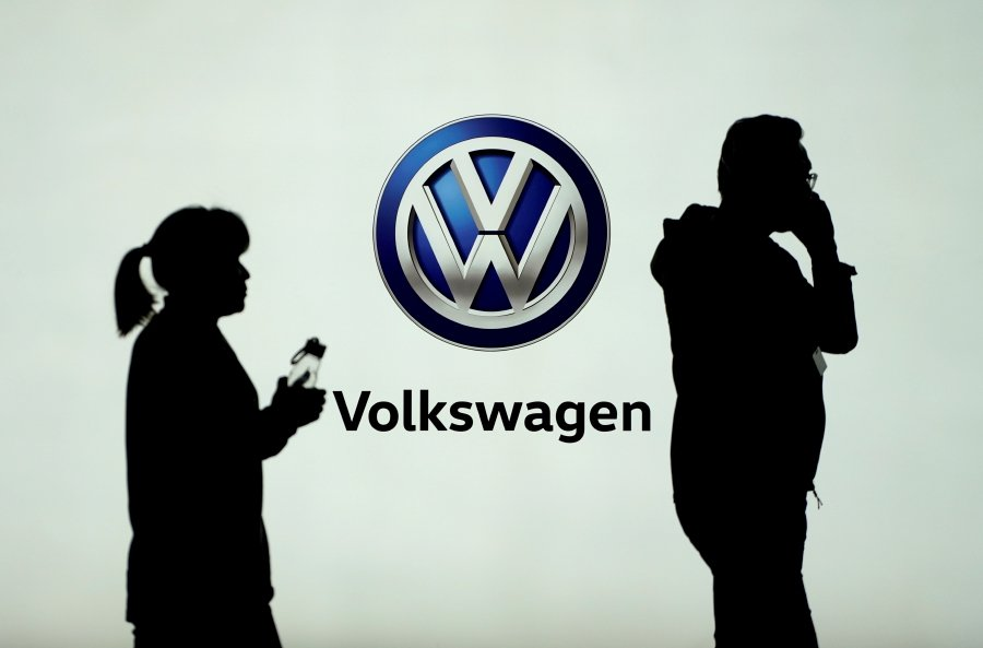 (File pix) People pass in front of a Volkswagen logo. Turkey is increasingly confident German carmaker Volkswagen will build a production plant in the country after an 'extremely positive' meeting between a senior company official and President Tayyip Erdogan this week, three Turkish sources said. Reuters Photo