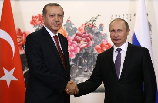 Russian President Vladimir Putin, right, and Turkish President Recep Tayyip Erdogan shake hands before their meeting ahead of the G20 Summit in Hangzhou, China, Saturday, Sept. 3, 2016. Yasin Bulbul, Presidential Press Service, Pool via AP
