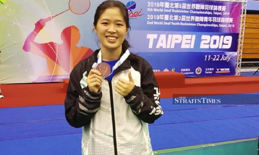 Boon Wei Ying poses with her bronze medal she won at the World Deaf Badminton Championships in Taiwan.