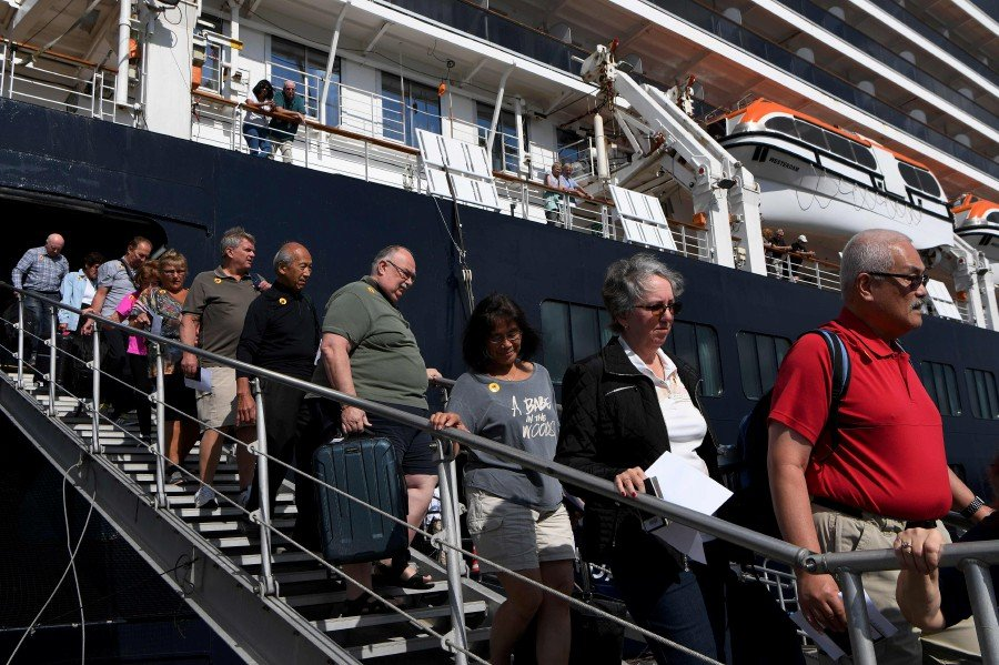 Passengers disembark from the Westerdam cruise ship in Sihanoukville. -AFP