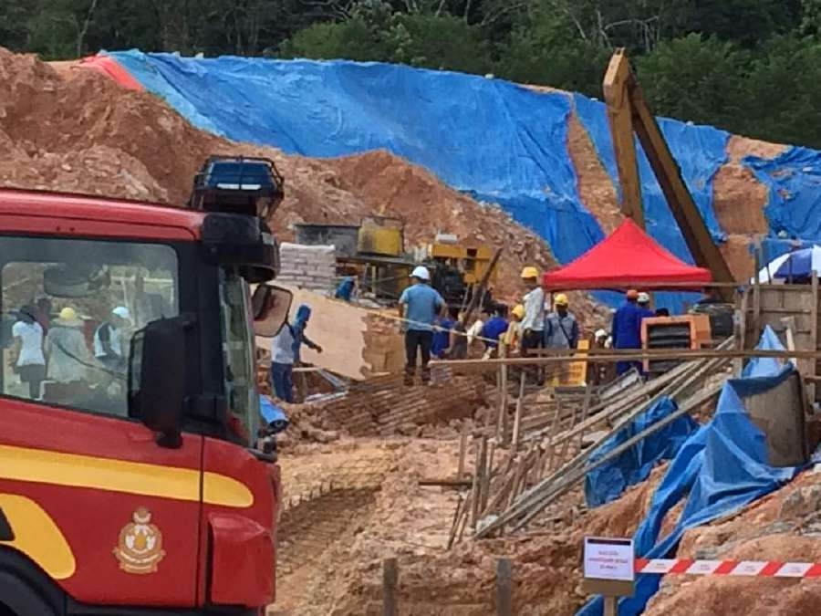 Up to 20 people buried in landslide at Penang construction site