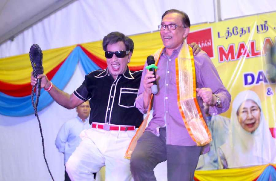 Image result for Anwar Ibrahim danced on stage with a Malaysian performer mimicking legendary Indian actor MG Ramachandran,