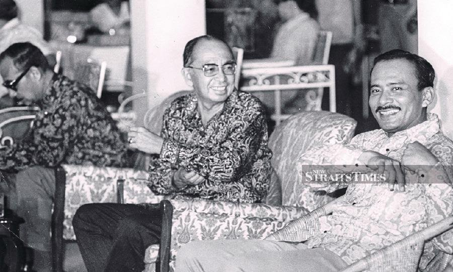 Tun Abdul Razak sharing a light moment with Tun Mohammed Hanif Omar while waiting for the results of the election in 1974.
