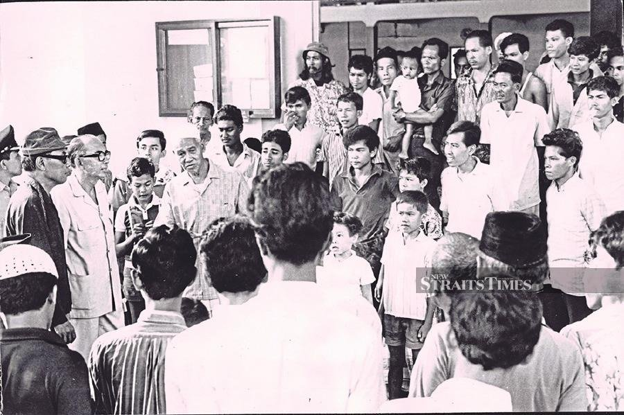 Tun Abdul Razak speaking to residents of Kampung Bahru during his tour of the worst affected areas during the 1969 riots.