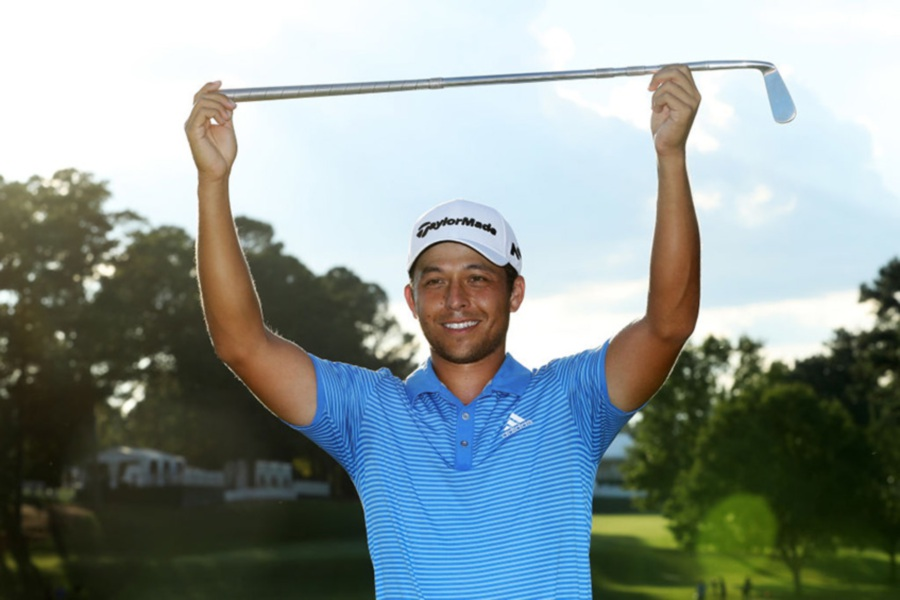 (File pix) ATLANTA, GA - SEPTEMBER 24: Xander Schauffele of the United States celebrates with the Calamity Jane trophy on the 18th green after winning during the final round of the TOUR Championship at East Lake Golf Club on September 24, 2017 in Atlanta, Georgia. (Photo courtesy of PGA Tour)