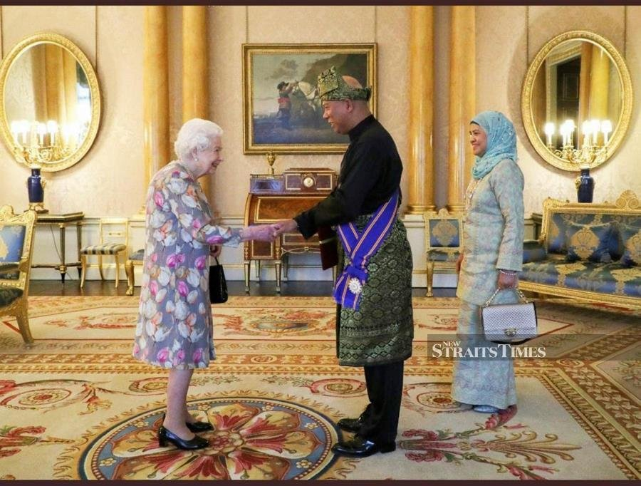 Datuk Mohamad Sadik Kethergany presents his credentials to Her Majesty Queen Elizabeth II at Buckingham Palace, London, on Oct 24. PICTURE COURTESY OF BUCKINGHAM PALACE