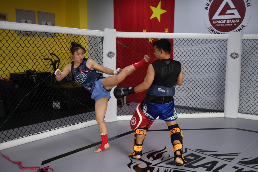Chinese mixed martial arts (MMA) fighter Zhang Weili (left) training at a gym in Beijing. - AFP