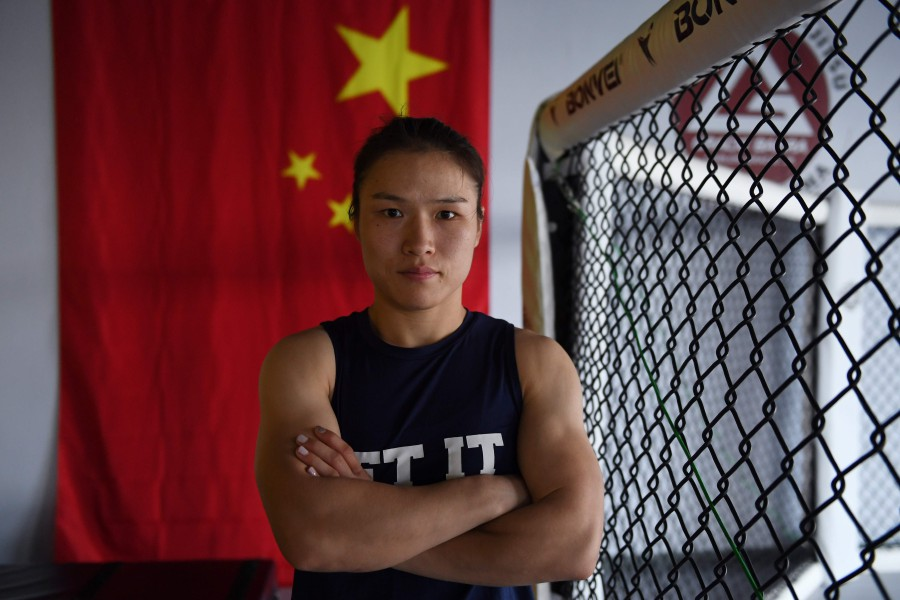 Zhang Weili steps out on August 31, 2019 as the first Chinese fighter to compete for a UFC title and with one person to thank for her remarkable rise in the sport: Ronda Rousey. -AFP
