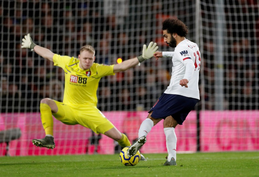 Liverpool's Mohamed Salah scores their third goal. -Reuters