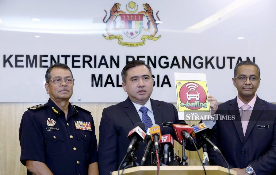Transport Minister Anthony Loke with Road Transport Department (RTD) director-general Datuk Seri Shaharuddin Khalid (left) and Land Public Transport Agency general director Azlan Shah Al Bakri (right) during the press conference at the ministry. -NSTP/Ahmad Irham Mohd Noor.