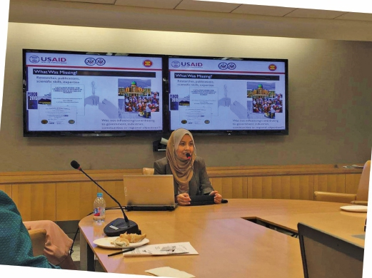 Nofri Yenita Dahlan presents her policy brief for Malaysia and the region at USAID in Washington, DC.