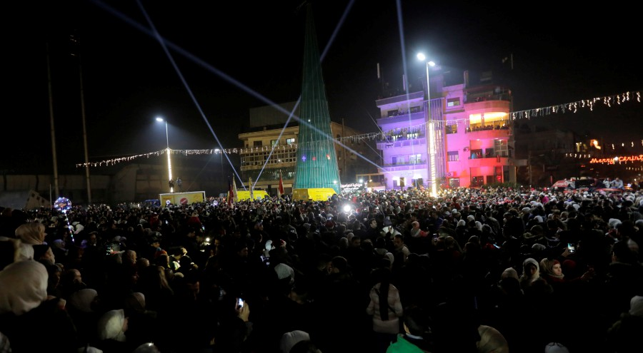 People attend a Christmas carnival in al-Abassyeen square in Damascus, Syria. - EPA