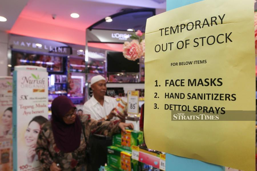 A notice posted at a pharmacy in Kuala Lumpur informing customers that it's out of stock of face masks, hand sanitizers and Dettol spray. - NSTP/MUSTAFFA KAMAL