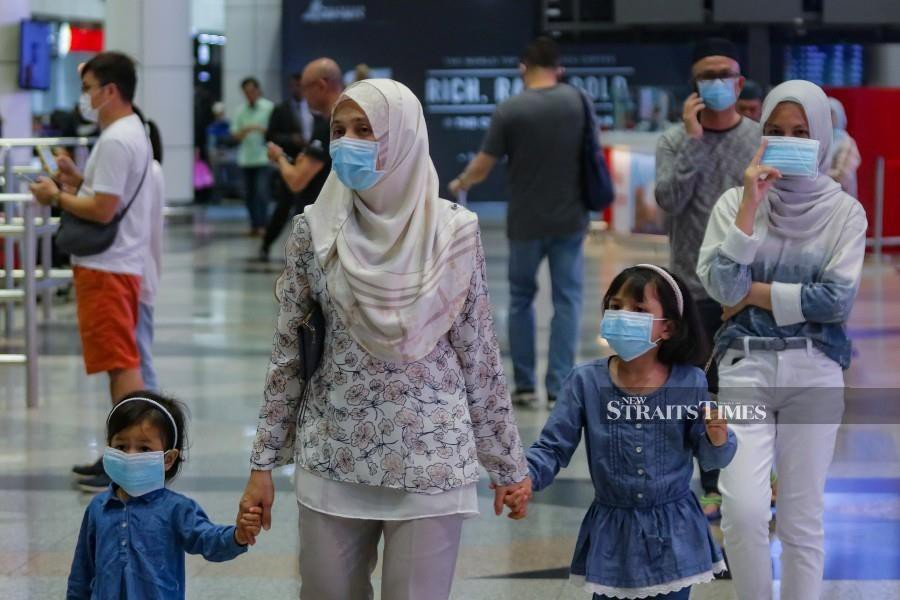 Members of the public seen wearing face masks at Kuala Lumpur International Airport. amid the coronavirus outbreak. - NSTP/File pic