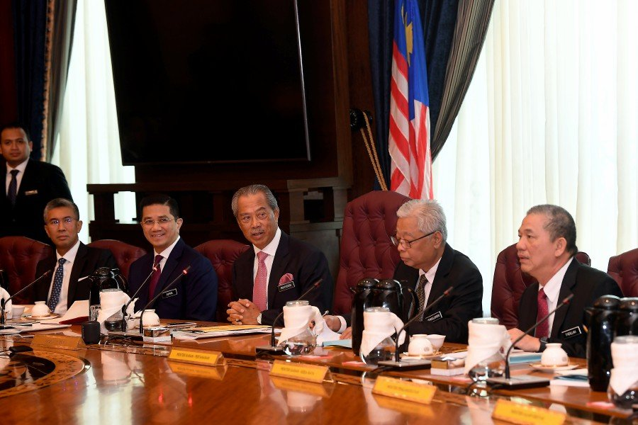 Prime Minister Tan Sri Muhyiddin Yassin (center) with Senior Minister-International Trade and Industry Minister Datuk Seri Mohamed Azmin Ali (second, left), Senior Minister-Defense Minister Datuk Seri Ismail Sabri Yaakob (second, right), Senior Minister-Works Minister Datuk Seri Fadillah Yusof (right) and Finance Minister Tengku Datuk Seri Zafrul Tengku Abdul Aziz (left) while chairing the first cabinet meeting in the Perdana Putra. - BERNAMA