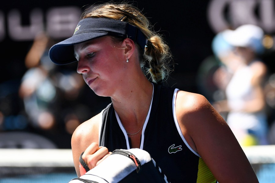 Estonia's Anett Kontaveit leaves the court after losing to Romania's Simona Halep in their women's singles quarter-final match on day ten of the Australian Open tennis tournament in Melbourne. -AFP