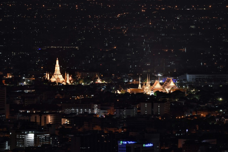 A general view taken from the viewing platform of the Baiyoke Sky Hotel in Bangkok late April 29, shows Wat Arun (L) and the Grand Palace (R) after the start of a curfew imposed in the Thai capital. -- Pix: AFP