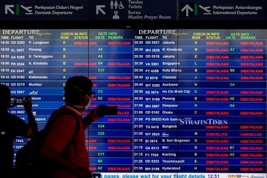 A view of the flight information monitors at Kuala Lumpur International Airport. -NSTP/AIZUDDIN SAAD