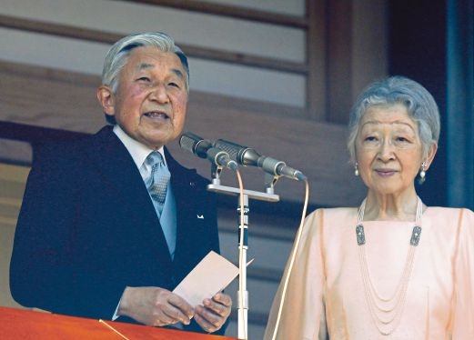 Japan's Emperor Akihito (left) accompanied by Empress Michiko expresses his thanks to well-wishers as he celebrates his 81st birthday at the Imperial Palace in Tokyo, Japan. EPA
