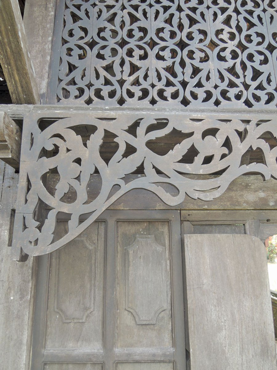 Each house features elaborate carvings.