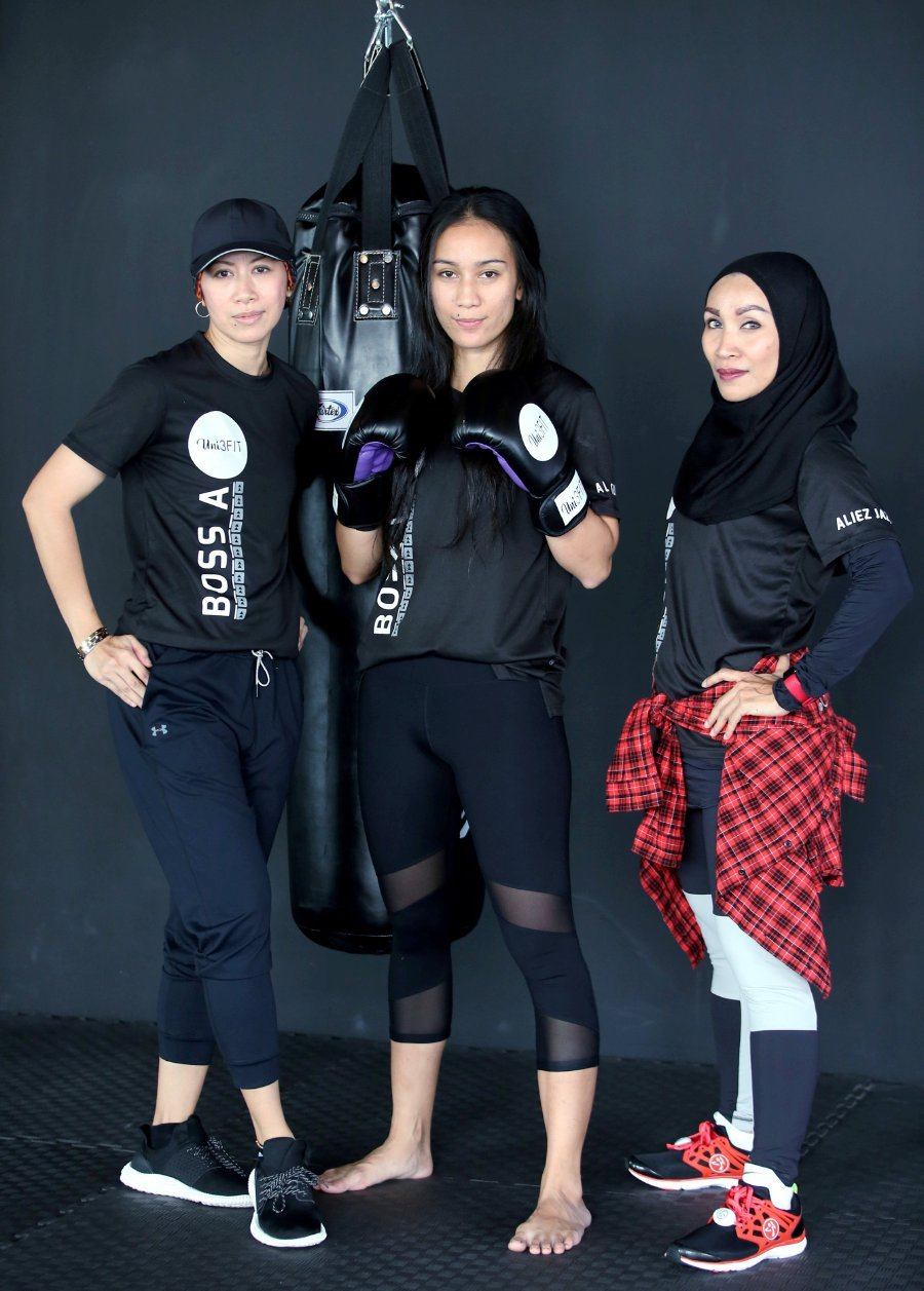 Aida (right) has set up a women-only fitness centre with Nur Amelia Abdul Wahab (left) and Amalia Syakirah Alia. Picture by Nur Adibah Ahmad Izam