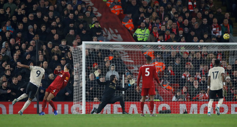 Manchester United's Anthony Martial shoots at goal. -Reuters