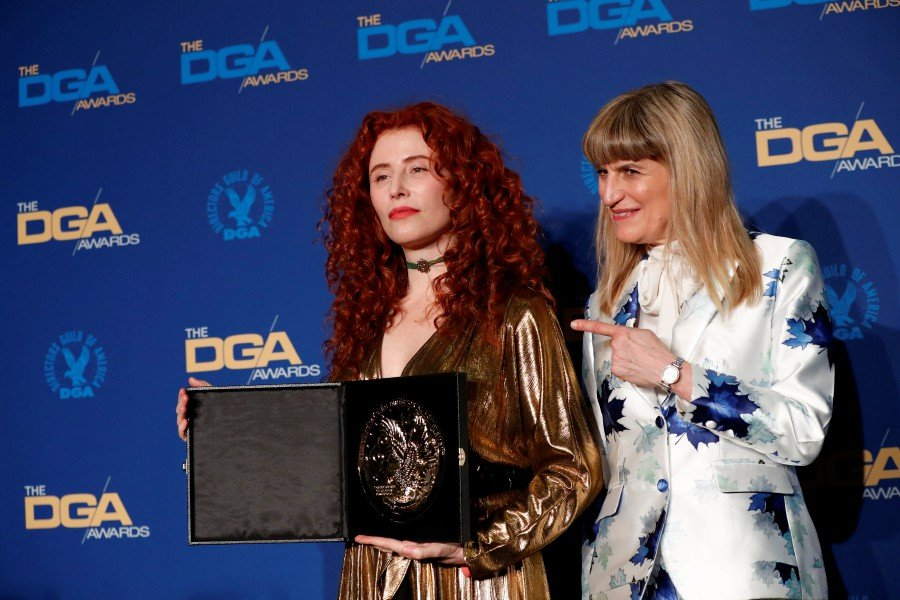 "Alma Har'el, director of ""Honey Boy"" poses with Catherine Hardwicke while holding her medallion after winning for Outstanding Directorial Achievement in First-Time Feature Film at the 72nd Annual Directors Guild Awards in Los Angeles, California. -Reuters"
