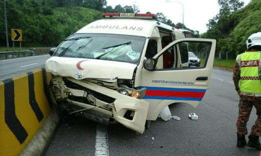 An ambulance crashes onto a road divider at Km256.7 of the North South Expressway southbound at 9.15am injuring two nurses.