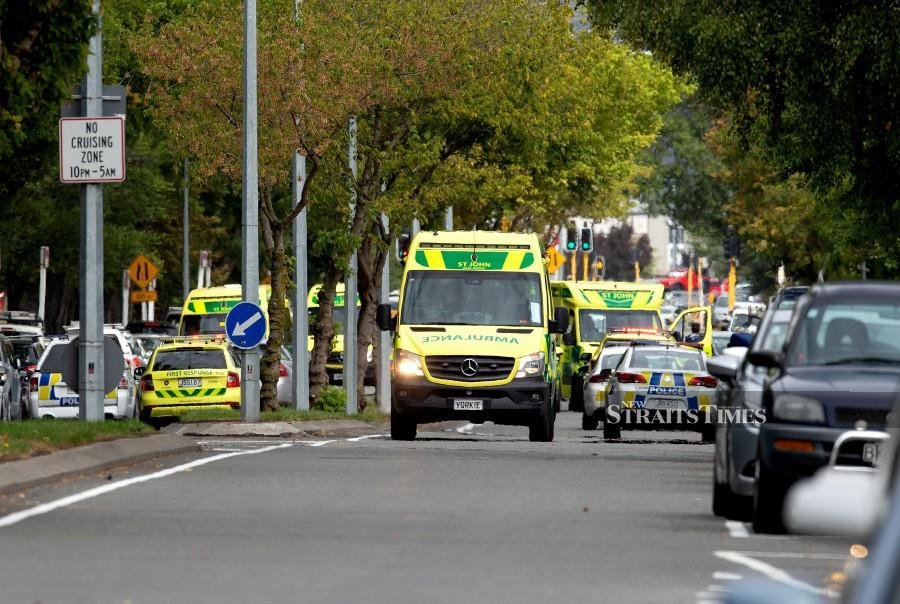 Ambulances and police outside the mosque following a shooting resulting in multiple fatalities and injuries at the Masjid Al Noor on Deans Avenue in Christchurch. - EPA