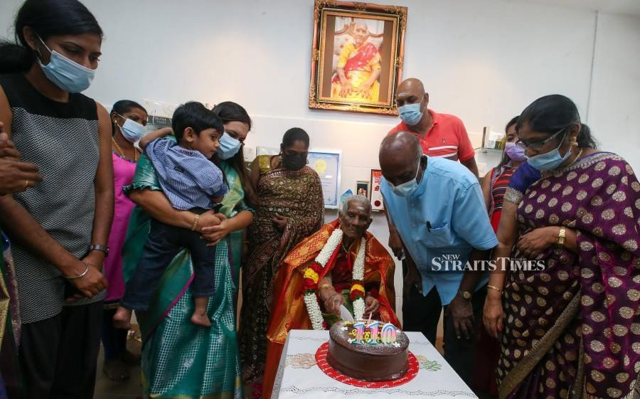 A. Annamah celebrates her 110the birthday with family members in Butterworth. - NSTP/DANIAL SAAD