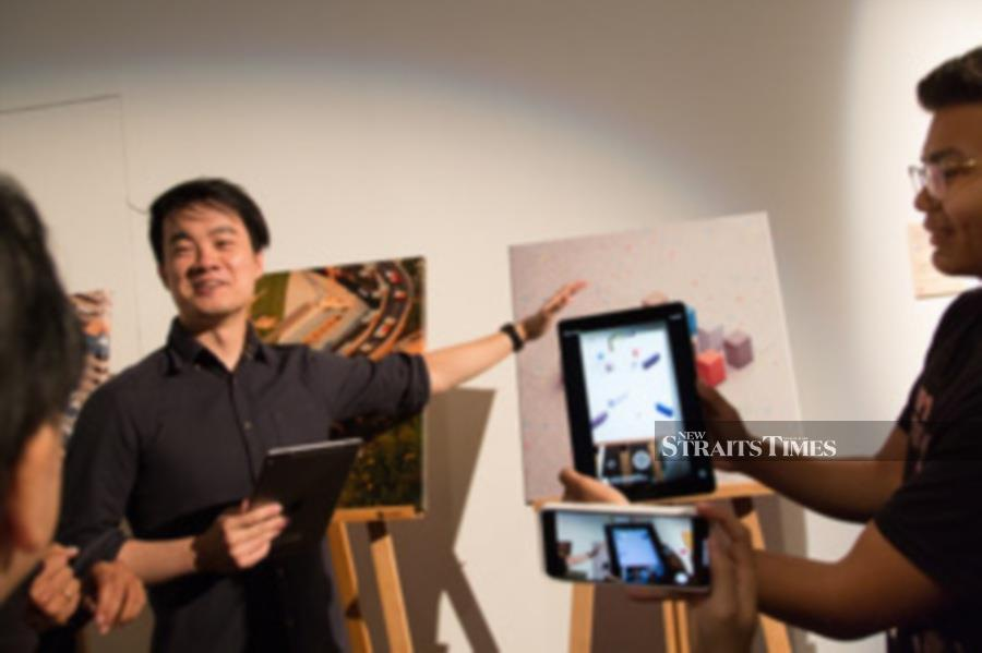 André Wee gives a demonstration of his work A Better Tomorrow.