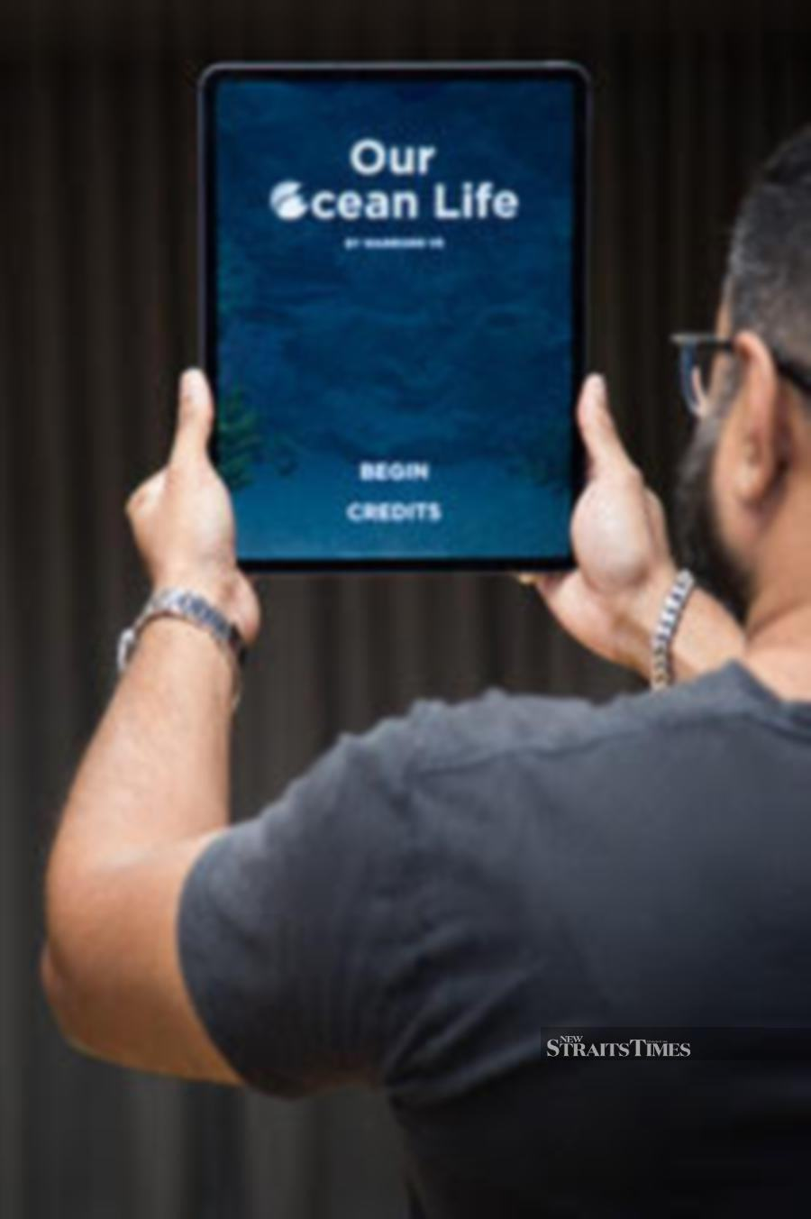 Immersive media company Warrior9 VR demonstrates their augmented reality experience Our Ocean Life.
