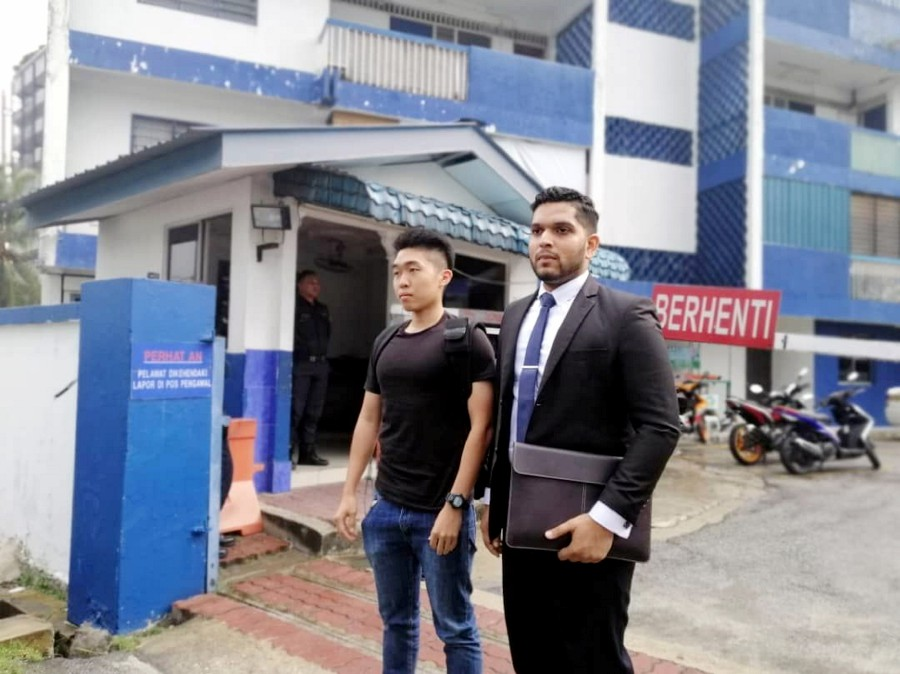 Wong Yan Ke (left) leaving the Petaling police station yesterday. With him is his legal representative, Asheeq Ali.