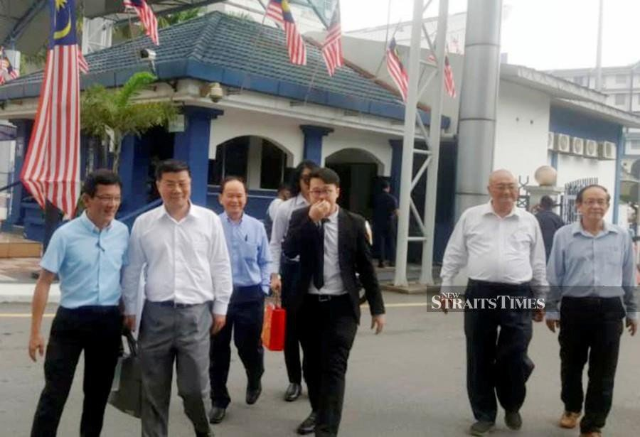 Dong Zong officials seen leaving the Bukit Aman headquarters after having their statement recorded. - Courtesy pic.