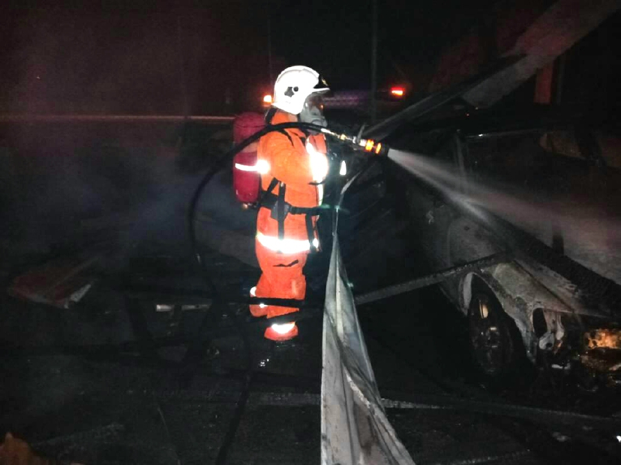 """""""We managed to snuff the blaze after an hour at 3.46am,"""" he said, adding that the vehicles belonging to RTD suffered 90 per cent burns. (Pics courtesy of Fire and Rescue Dept)"""