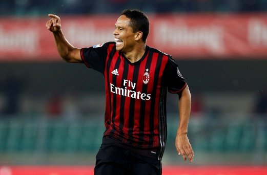 AC Milan's Carlos Bacca celebrates after Chievo's Dario Dainelli scored an own goal. REUTERS.