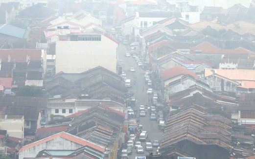 An aerial of Georgetown covered in thick smoke this morning. Pix by Danial Saad