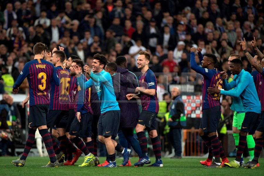 1d3bece6d69 Barcelona s players celebrate at the end of the Spanish league football  match between Real Madrid CF and FC Barcelona at the Santiago Bernabeu  stadium in ...