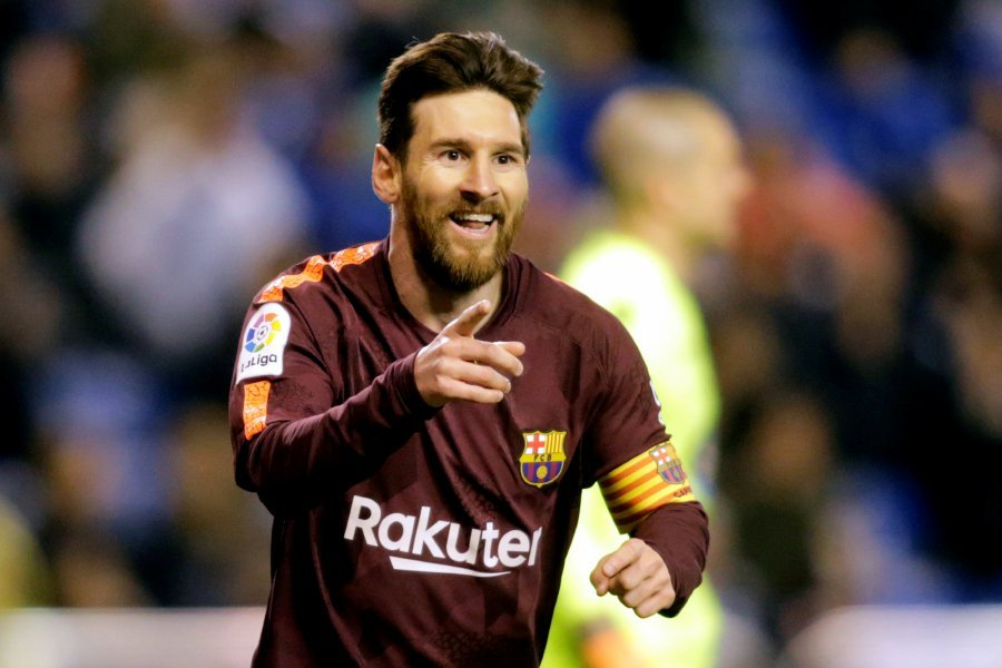 Barcelona wins Spanish league title with Messi hat trick